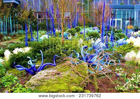 March 8, 2018 In Seattle, Wa:  Glass Sculptures Surrounded By Plants Taken In A Garden At The Chihul