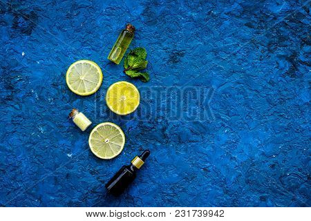 Natural Citrus Cosmetics. Spa Oil Near Lemon On Blue Background Top View Mock-up.
