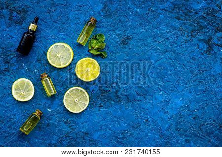 Organic Cosmetic With Lemon For Homemade Spa With Oil And Fresh Fruit On Blue Background Top View Mo