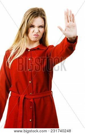 Assertive Woman Denying. Female Showing Stop Sign Gesture Using Palm Of Her Hand.