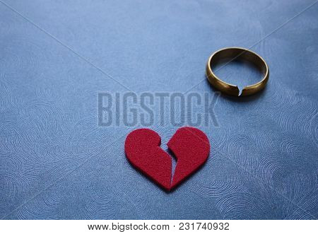 A Broken Red Heart And Cracked Gold Wedding Ring