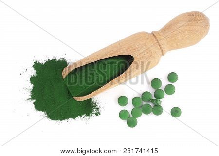 Spirulina Algae Powder And Pills In Wooden Scoop Isolated On White Background. Top View.