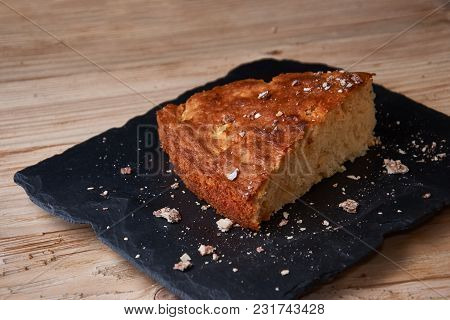 Delicious Fresh Baked Piece Of Apple Pie On Wooden Background