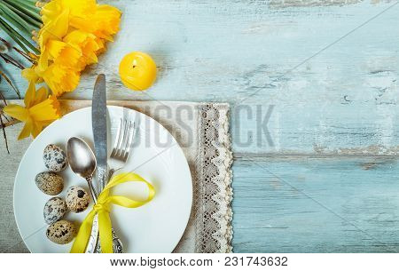 Easter Table Setting With Daffodil, Eggs And Cutlery. Holidays Background