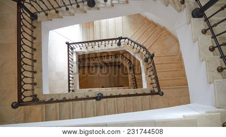 Top View Of The Spiral Staircase With Fence