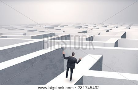 Small businessman in a middle of a huge maze