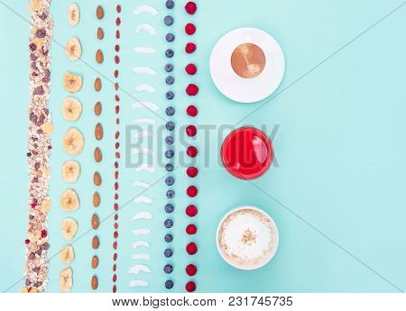 Breakfast With Berries And Nuts On Mint Background, Copy Space. Colorful Healthy Eating Concept.