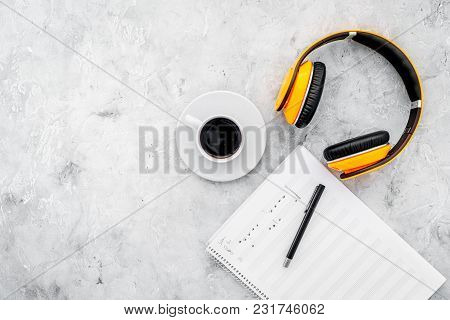 Work Space Of Composer Or Dj With Headphones And Notes On Gray Background Top View Mock-up
