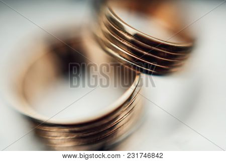 Gold Wedding Rings On A White Background. Close Up