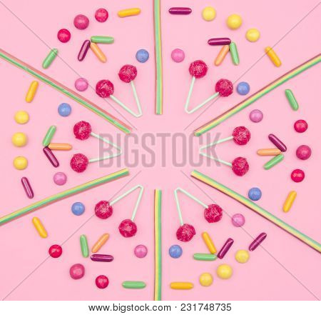 Assorted Colored Candies On Pink Background. Flat Lay, Top View.
