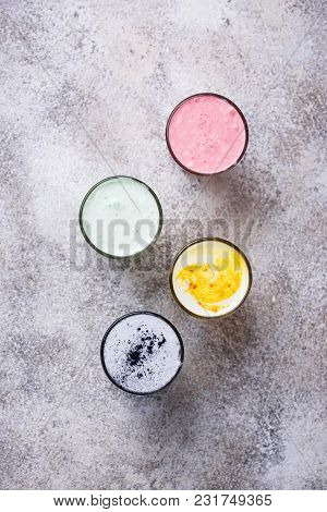 Colorful Super Lattes With Charcoal, Beetroots, Matcha Tea And Turmeric. Top View