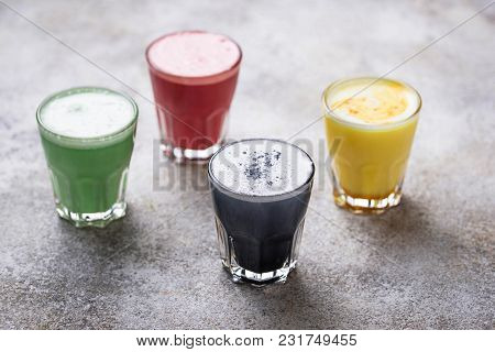 Colorful Super Lattes With Charcoal, Beetroots, Matcha Tea And Turmeric. Selective Focus