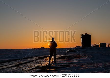 Horizontal Silhouette Image Of A Woman Standing In Front Of The  Georgeous Evening Sun In Front Of S