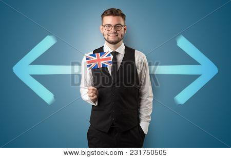 Handsome young boy choosing target country with arrows on the background