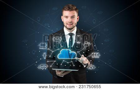 Chalk drawn cloud technology symbols on a tabled handled by businessman