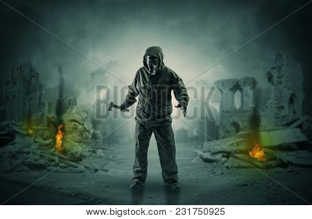 Destroyed place after a catastrophe with man in gas mask and weapon on his hand