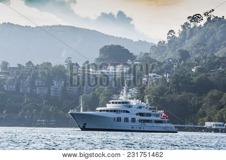 Yacht Anchored In The Vicinity Of The Harbor Of The Island Of Phuket Back You Can See The Houses Of