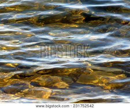 Soft Ripples On Surface Of Clear Lake Waters