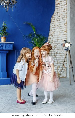 Three Children Sing A Song In A Microphone. Group. The Concept Is Childhood, Lifestyle, Music, Singi