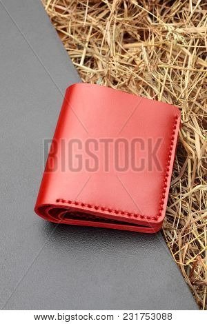 Hand Made Red Leather Man Wallet . Multi Colored. Leather Craft.on Dark Background.top View