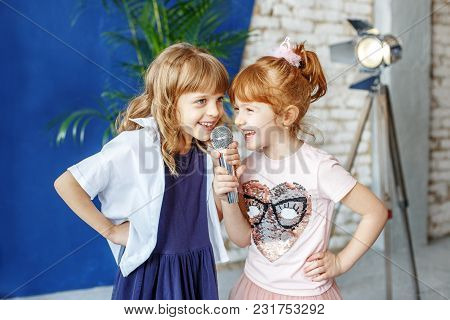 Two Funny Children Sing A Song In Karaoke. The Concept Is Childhood, Lifestyle, Music, Singing, Frie