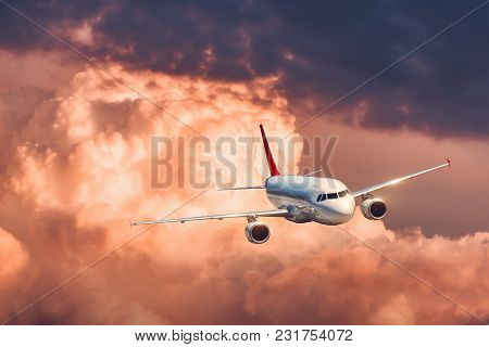 Beautiful Airplane Is Flying In Colorful Clouds