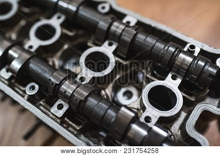 Motor head, valve, cam-shaft, from a motorcycle or car. Close-up shot
