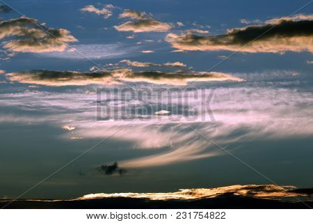 The Expressive Contrast Of The Clouds In The Sky