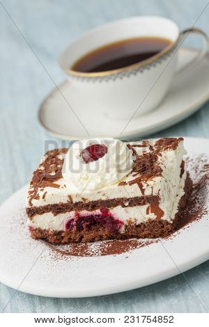 Black Forrest Cake On A Plate With Coffee