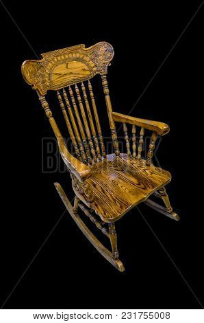 Wooden Carved Chair Rocking Brown On A Black Background, Isolated