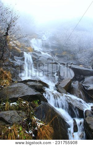 Cascade Waterfall In Mountains. Mountain River Turns Into Waterfall. Water Landscape In Forest. Fall