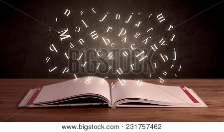 Glowing alphabet letters coming out of an open book