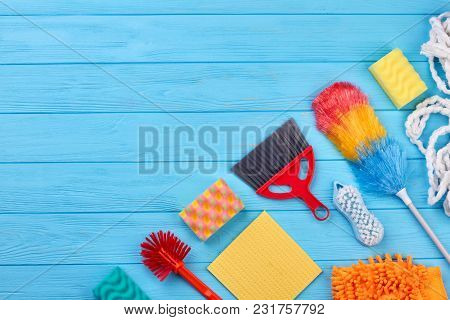 House Cleaning Products, Copy Space. Flat Lay House Cleaning Supplies On Blue Wooden Table. Homework