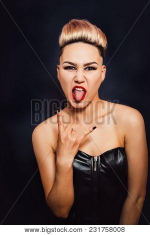 Woman Shows Rocker Goat Gesture Close Up