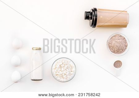 Protein Powder For Fitness Nutrition To Start Training And Eggs And Milk On White Desk Background To