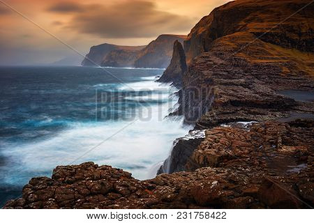 Bosdalafossur Waterfall On Vagar Island Coastline In Sunset, Faroe Islands