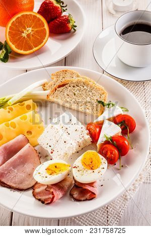 English breakfast on wooden table