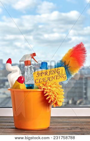 Bucket With Cleaning And Washing Items. Plastic Bucket With Cleaning Products On Window Background.