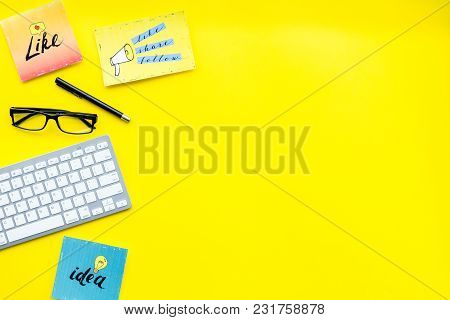 Socail Media Icons On Work Desk Of Marketing Expert. Digital Promotion Of Goods And Services. Yellow