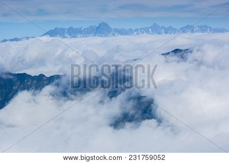 Beautiful Clouds And Foggy Landscape In High Altitude Mountains