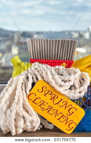 Pile Of Products For House Cleaning. Items For Spring Cleaning. Spring Cleaning Background.