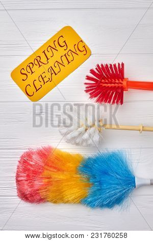 Spring Cleaning Concept With Supplies. Set Of Brushes For Cleaning On Wooden Background. Cleaning Se