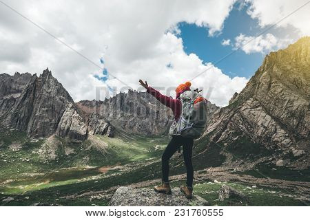 Cheering Woman With Backpack Hiking In Mountains Travel Lifestyle