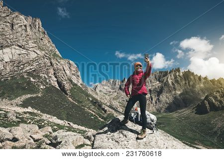 Successful Woman Hiker Use Smartphone In Mountain Top Rock