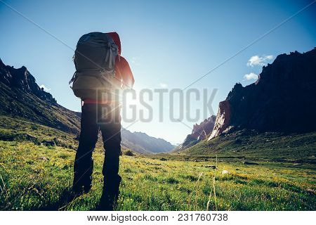 Cheering Woman Hiker With Backpack Hiking On High Altitude Mountain