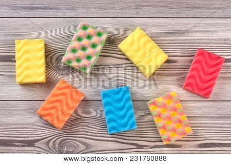 Multicolored Kitchen Sponges, Wooden Background. Set Of Colorful Sponges For Washing Dishes On Wood.