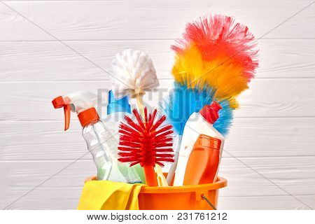 Close Up Colorful Brushes For House Cleaning. Variety Of Chemicals For House Cleaning On White Woode