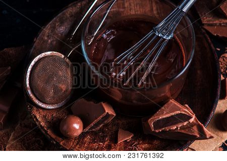 Close-up Of Chocolate Glazing In A Glass Cup With A Whisk. Cocoa Powder, Cinnamon And Other Spices O