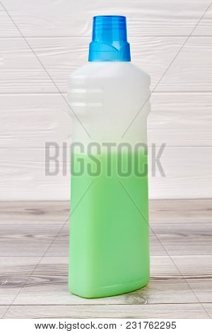 Plastic Bottle Of Rinser For Washing Clothes. Used Softener For Washing On Wooden Background. Condit