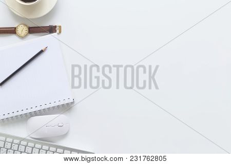 White Desk Office With Laptop, Smartphone And Other Supplies With Cup Of Coffee. Top View With Copy